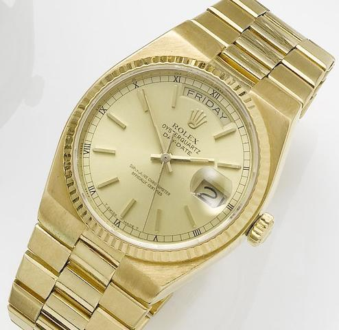 Rolex. An 18ct gold quartz centre seconds calendar bracelet watchOysterquartz, Day-Date, Ref:19018, Circa 1977