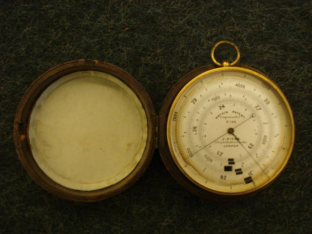 "J Hicks, 89 & 10 Hatton Garden, London - A Watkin patent aneroid barometer, No. 168, the silvered dial to record between 21"" and 31"" in a gilt metal drum case, fitted morocco outer case, 7-8cm."