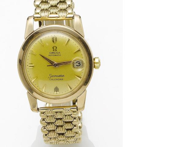 Omega. An 18ct gold automatic calendar bracelet watch Seamaster, 1950's