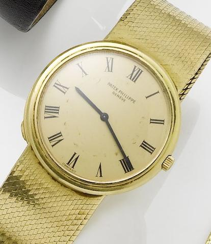 Patek Philippe. An 18ct gold automatic bracelet watch