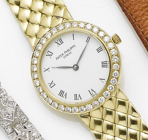 Patek Philippe. A lady's 18ct gold quartz bracelet watch