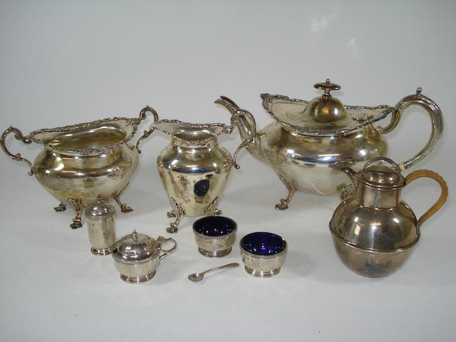 A A three-piece silver tea service; silver condiments and a silver jug