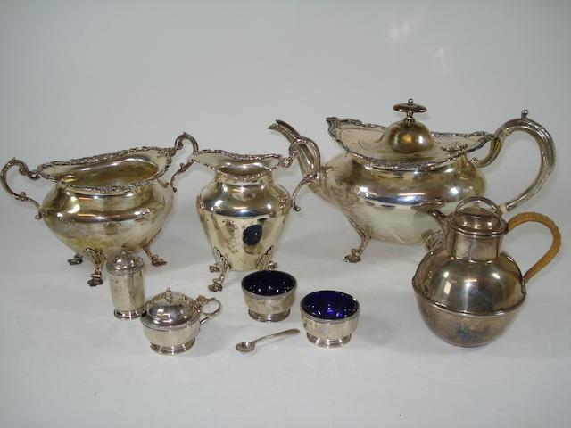 A A three-piece silver tea service; silver condiments and a silver jug