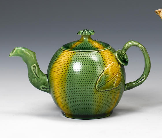 A Staffordshire lead-glazed miniature 'melon ware' teapot and cover circa 1765-70