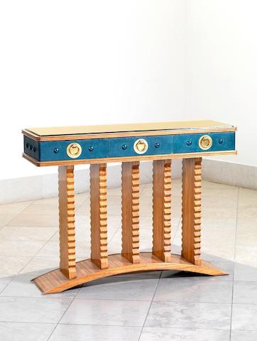 Laszlo Hoenig, a console table, circa 1958 walnut and leather with brass fittings, the top with a tooled gold leaf design under glass