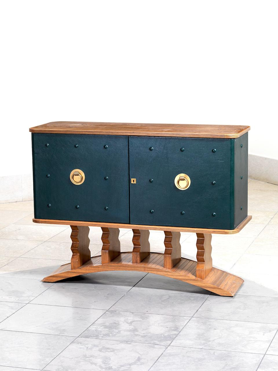 Laszlo Hoenig, a sideboard, circa 1958 walnut and leather with brass fittings