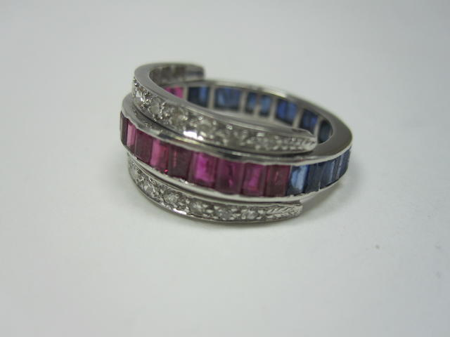 A sapphire, ruby and diamond swivel eternity ring