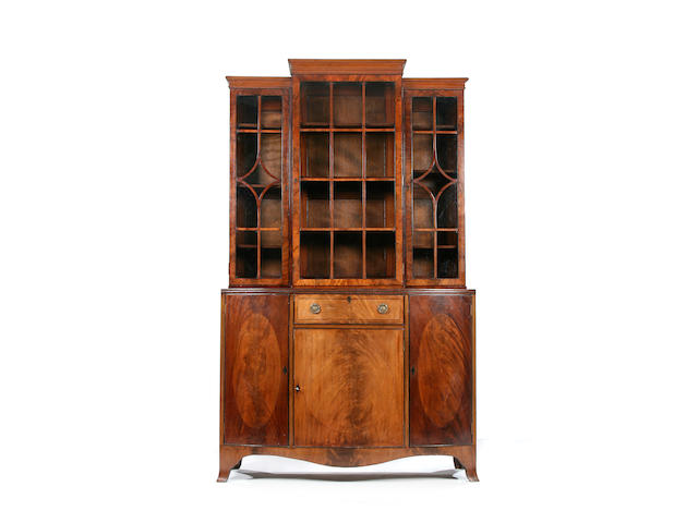 A Maple & Co mahogany bowfront bookcase cabinet, 20th Century Bearing metal 'Maple & Co.' label to interior