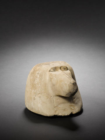 An Egyptian limestone canopic jar stopper of Hapy