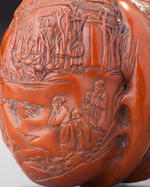 A carved and engraved walnut snuff bottle Imperial, probably palace workshops, Beijing, Qianlong seal mark and of the period, 1736–1799