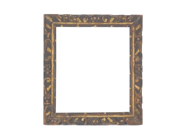 An Italian 16th Century carved, polychromed and parcel gilt Sansovino frame