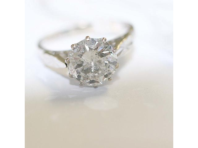 A solitaire diamond ring,