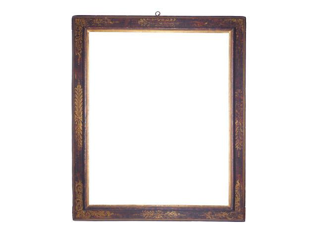 An Italian 17th Century carved, polychromed and parcel gilt cassetta frame