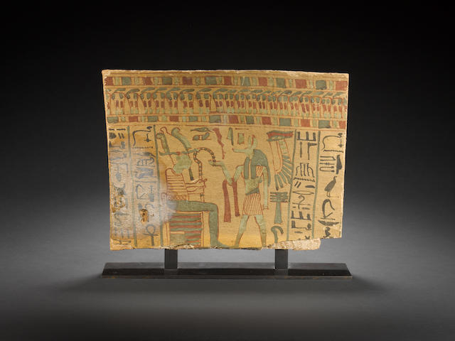 An Egyptian wood sarcophagus panel