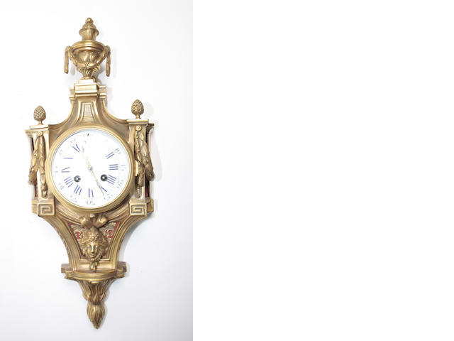 A late 19th century gilt metal cartel clock