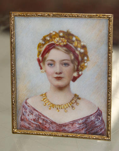 An 20th Century portrait miniature Young woman with fringe necklace and dressed hair