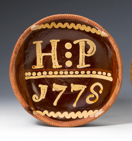 A Slipware dish, inscribed HP1778 dated 1778