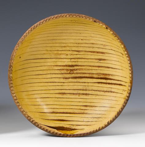 A Staffordshire slipware dish mid 18th century