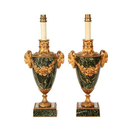 A pair of Louis XVI style Verde Antico and gilt bronze mounted lamp bases
