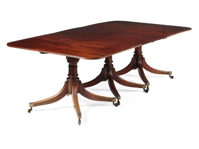 A mahogany three pillar dining table