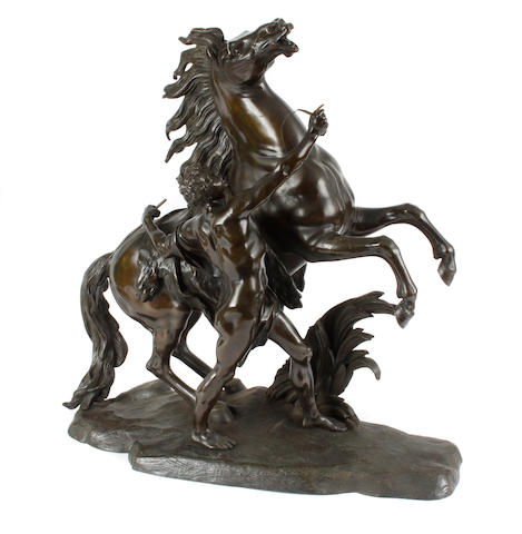 A large bronze Marley horse groupafter CoustouThe horse being restrained by a groom, 59cm high.