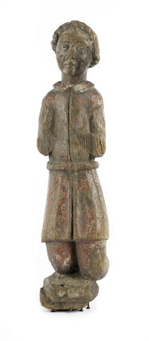 A 15th century North European carved wood and polychrome decorated figure of a pilgrimpossibly English
