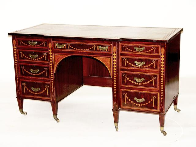 An Edwardian inlaid mahogany kneehole desk by Maple & Co