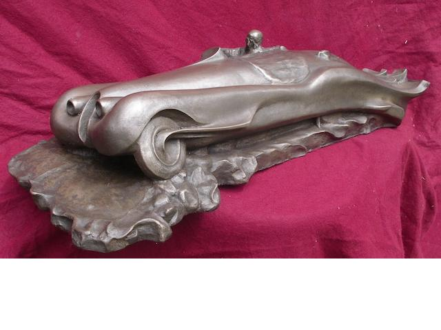 A cold cast Art Deco style XK120 sculpture,