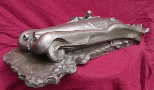 A cold cast Art Deco style XK120 sculpture,