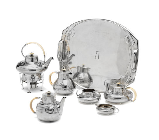 Archibald Knox for Liberty & Co. An important 'Cymric' silver and ivory Tea and Hot Chocolate Service on Tray, 1903 and 1905