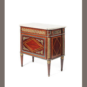 A 19th century French kingwood commode in the Transitional style