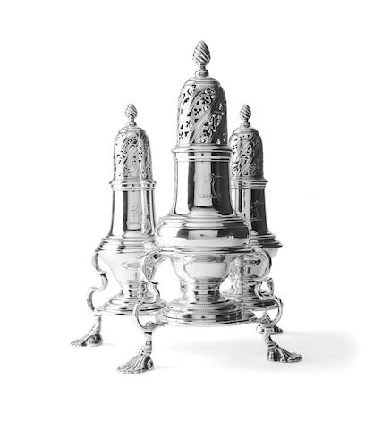 A George III three piece silver sugar caster set on stand By John Delmester, London 1761