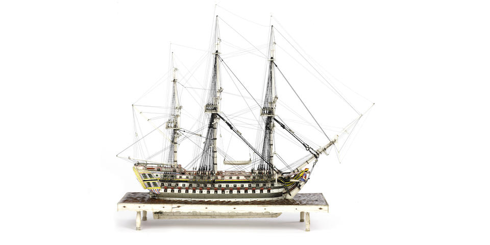 A Napoleonic Prisoner of War bone model of a 90 gun ship of the line. Model 20in(51cm)long, 22.5x24.5x10in(57x62x25.5cm)