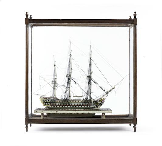 A Napoleonic Prisoner of War bone model of a 90 gun ship of the line. Model 20in(51cm)long, 22.5x24.5x10in(57x62x25.5cm)