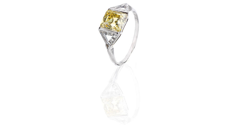 An early 20th century yellow diamond and diamond ring, French