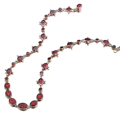 An early 19th century garnet and seed pearl necklace