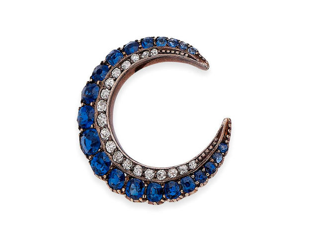 A sapphire and diamond crescent brooch,