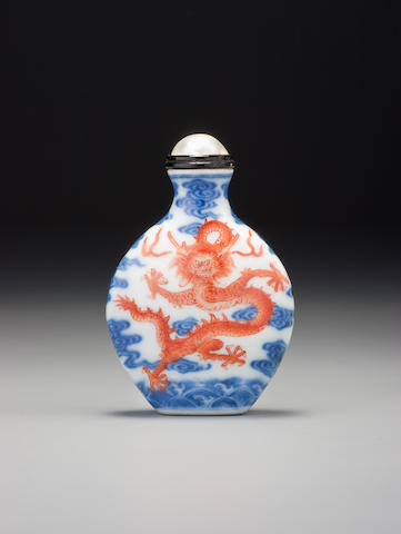 An iron-red and underglaze-blue porcelain 'dragon' snuff bottle Imperial kilns, Jingdezhen, Qianlong iron-red seal mark and of the period, 1736–1795