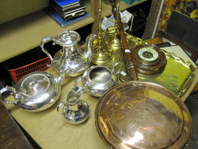 A Victorian electroplate four piece tea and coffee service,foliate embossed, Arts & Crafts brass two handled tray, pair of tall brass candlesticks, in 18th Century style, barometer, and two early 19th Century copper warming pans with turned fruitwood and mahogany handles. (10)