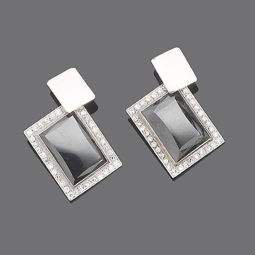 A pair of hematite and diamond cufflinks