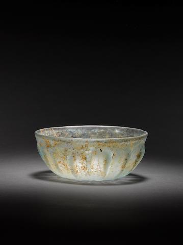 A Roman pillar-moulded glass bowl