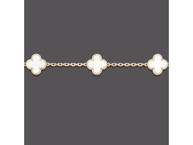 A mother-of-pearl 'Alhambra' necklace and bracelet suite, by Van Cleef and Arpels (2)