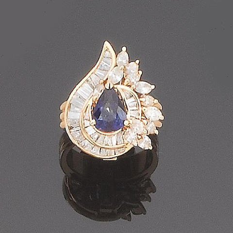 A tanzanite and diamond cluster ring/pendant