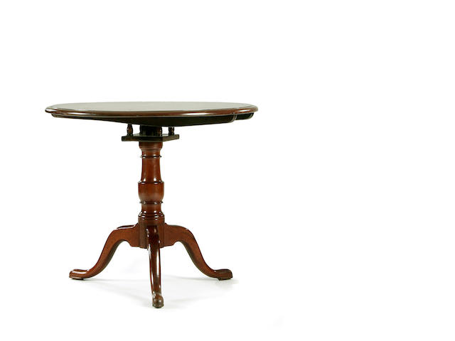 A George III and later mahogany pedestal table