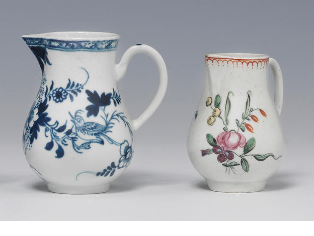 A Liverpool, Philip Christian factory, sparrow beak jug, c. 1768, with a grooved handle, painted in blue with the so-called Liver Bird pattern and A Philip Christian small sparrow beak jug, , c.1768, formal coloured flowers and a red 'crowsfoot' border