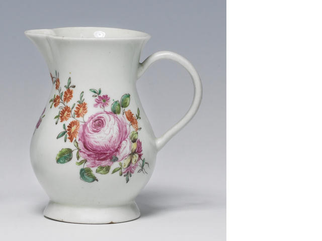 A Chaffers small cream jug, c.1758, with a strap handle, painted formal European flowers (small chip to foot)
