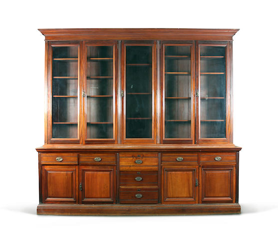 A large late Victorian mahogany library bookcase Bearing ivorine label reading 'Goodall, Lamb & Heighway Ld., Cabinet Makers & Upholsterers, Manchester'