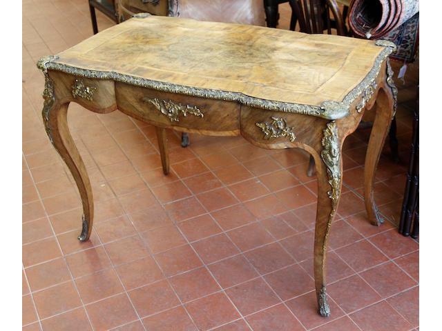 A Louis XV style gilt metal mounted walnut bureau plat,
