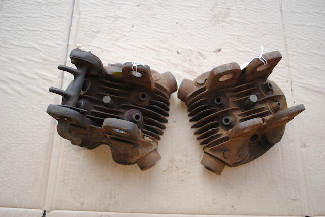 Two four-valve cylinder heads,