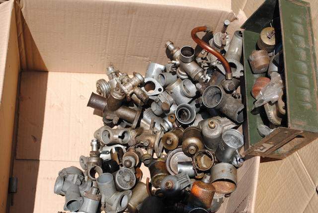 A large quantity of carburettors, and carburettor spares,